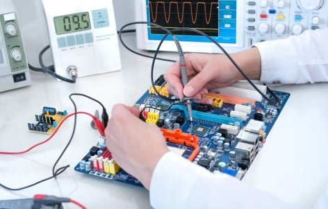 Technician Working on Electronics