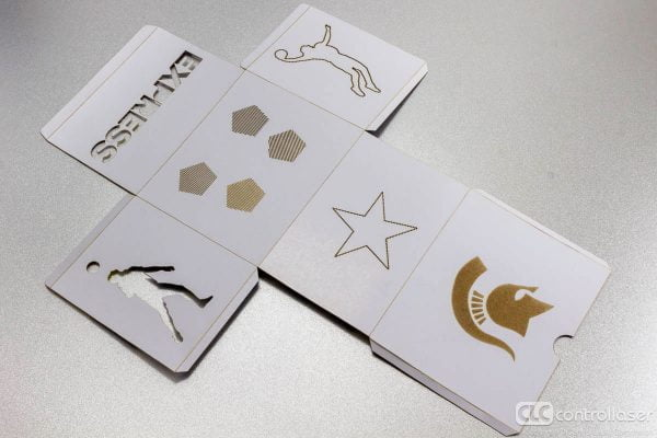 Laser die cutting of cardboard product packaging