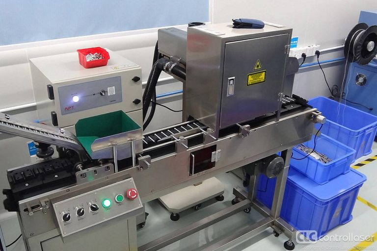 Laser marking of metal products on moving conveyor lines